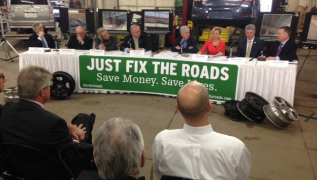 Governor Snyder discusses fixing the roads in Grand Rapids. Photo courtesy of Woodtv.com