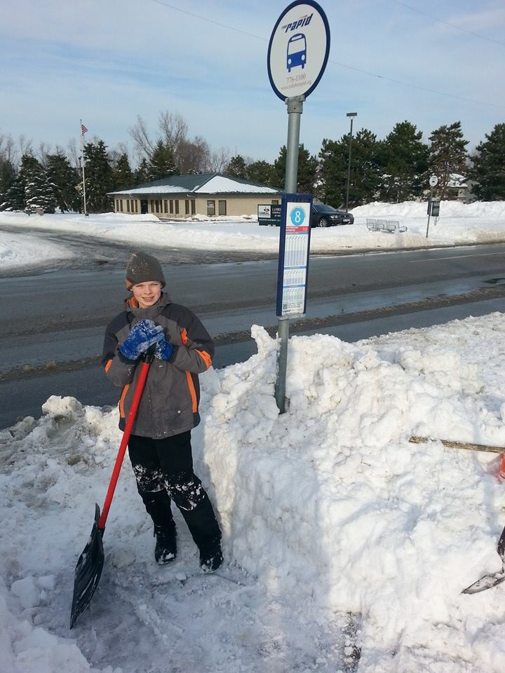 A young Grandville Snow Angel clears a stop after school