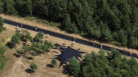 This trampoline in a Russian forest is 170 feet long, or the extra sight distance that AASHTO recommends when increasing speeds from 70 to 80 mph